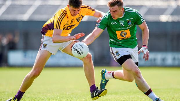 14 June 2015; Kieran Martin, Westmeath, in action against Naomhan Rossiter, Wexford. Leinster GAA Football Senior Championship Quarter-Final, Westmeath v Wexford. Cusack Park, Mullingar, Co. Westmeath. Picture credit: Paul Mohan / SPORTSFILE