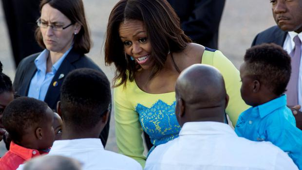 U.S. first lady Michelle Obama speaks with wellwishers at Stansted Airport, southern England June 15, 2015. REUTERS/Neil Hall