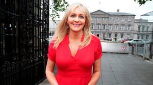 In the background the tall shadow of RTÉ's Miriam O'Callaghan, looms. Is her coyness a case of 'just ask me'? Photo: Tom Burke