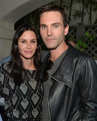 """Actress Courteney Cox and songwriter Johnny McDaid attend Kevin Morris' """"White Man's Problem"""" book release party"""