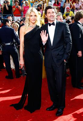 Actor Patrick Dempsey (R) arrives with his wife Jillian Dempsey at the 60th Primetime Emmy Awards