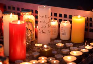 Candles - some with names written on it - sit on a table tennis table in front of the Joseph-Koenig Gymnasium in Haltern, western Germany Tuesday, March 24, 2015. (AP Photo/Martin Meissner)