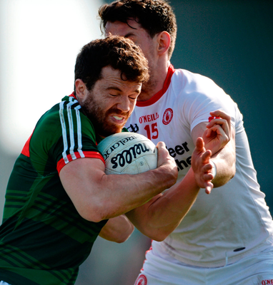 Moyo's Chris Barrett in action against Matthew Donnelly of Tyrone at Healy Park in Omagh. Photo: Oliver McVeigh/Sportsfile