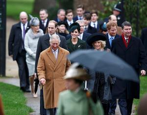 Britain's Prince Charles and his wife Camilla arrive ahead of Prince William and Kate, and other members of the royal family, to attend the Christmas Day service at church in Sandringham, eastern England, December 25, 2015. REUTERS/Peter Nicholls