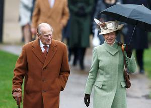 Britain's Prince Philip and Princess Anne arrive to attend the Christmas Day service at church in Sandringham, eastern England, December 25, 2015. REUTERS/Peter Nicholls