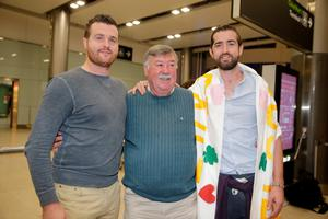 Barry (left) and Patrick Lyttle with their father Oliver at Dublin Airport after arriving home from Australia. Picture:Arthur Carron