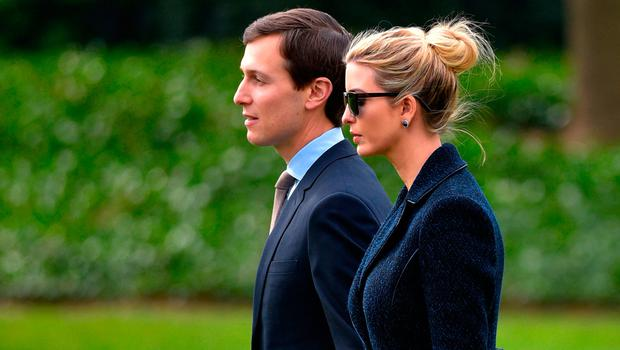 Senior Advisor to the President, Jared Kushner (L), walks with his wife Ivanka Trump to board Marine One at the White House in Washington, DC, on March 3, 2017.