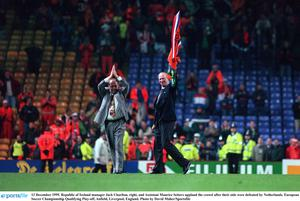 Jack Charlton, right, and assistant Maurice Setters applaud the crowd after their side were defeated by Netherlands, Jack's final game in 1995