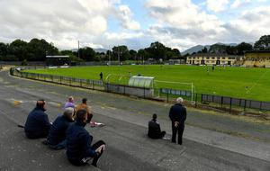 Keeping their distance: Supporters look on during the Kerry County SFC Group 2 Round 1 match between Kilcummin and Killarney Legion at Lewis Road in Killarney. Photo: Brendan Moran/Sportsfile