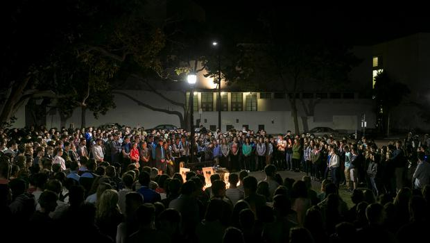Hundreds of people attend a candlelight vigil for the victims of the Berkeley balcony collapse