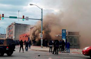 Smoke billows from a CVS Pharmacy store in  Baltimore. Demonstrators clashed with police after the funeral of Freddie Gray. Photo: AP