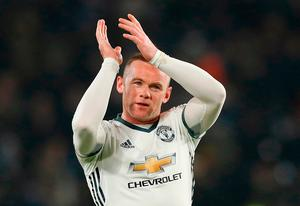 Manchester United's Wayne Rooney celebrates after the final whistle during the EFL Cup Semi Final, Second Leg match against Hull at the KCOM Stadium. Photo: PA