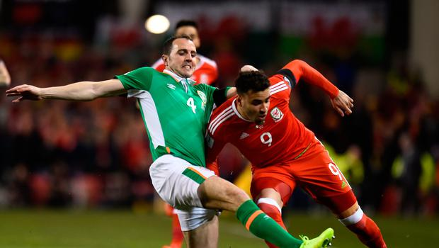 Football Soccer - Republic of Ireland v Wales - 2018 World Cup Qualifying European Zone - Group D - Aviva Stadium, Dublin, Republic of Ireland - 24/3/17 Republic of Ireland's John O'Shea in action with Wales' Hal Robson-Kanu Reuters / Clodagh Kilcoyne Livepic