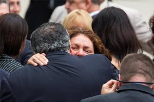 Actress Aida Turturro embraces a fellow mourner as she arrives for the funeral services of James Gandolfini outside the Cathedral Church of Saint John the Divine in New York REUTERS/Lucas Jackson