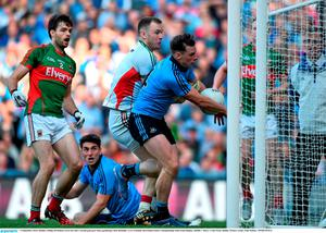 5 September 2015; Dublin's Philip McMahon scores his side's second goal past Mayo goalkeeper Rob Hennelly. GAA Football All-Ireland Senior Championship Semi-Final Replay, Dublin v Mayo. Croke Park, Dublin. Picture credit: Paul Mohan / SPORTSFILE