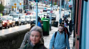 Commuters take to cars and walking to get to work and school in Dublin. Photo: Mark Condren