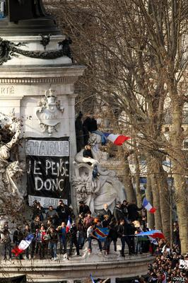 Demonstrators gather in Place de la Republique prior to a mass unity rally to be held in Paris following the recent terrorist attacks