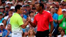 Rory McIlroy and Tiger Woods Photo: Ross Kinnaird/Getty Images