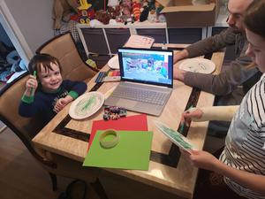 Happy family: Isaac Keenan and sister Madison join dad Dean to watch the Barretstown broadcast