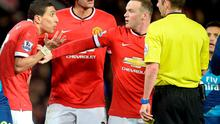 Manchester United's Angel Di Maria (left) is held by teammate Wayne Rooney as he protests to referee Michael Oliver before being sent off during the FA Cup, Sixth Round match at Old Trafford, Manchester. PRESS ASSOCIATION Photo. Picture date: Monday March 9, 2015. See PA story SOCCER Man Utd. Photo credit should read: Martin Rickett/PA Wire. RESTRICTIONS: Editorial use only. Maximum 45 images during a match. No video emulation or promotion as 'live'. No use in games, competitions, merchandise, betting or single club/player services. No use with unofficial audio, video, data, fixtures or club/league logos.