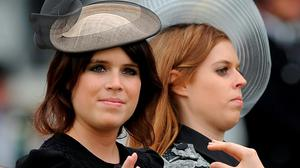 Sarah Ferguson and Prince Andrew's two daughters, Princesses Eugenie and Beatrice. Photo by Charlie Crowhurst/Getty Images for Ascot Racecourse