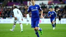 Oscar celebrates after scoring Chelsea's fourth goal in their win over Swansea City at the Liberty Stadium. Photo: Richard Heathcote/Getty Images