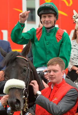 Pat Smullen celebrates on Harzand after winning the Dubai Duty Free Irish Derby at the Curragh in June 2016. Photo: Sportsfile