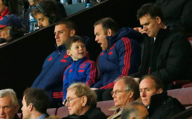 """Football Soccer - Manchester United v West Ham United - Barclays Premier League - Old Trafford - 5/12/15 Manchester United's Wayne Rooney in the stands with Sam Johnstone and son Kai  Action Images via Reuters / Lee Smith Livepic EDITORIAL USE ONLY. No use with unauthorized audio, video, data, fixture lists, club/league logos or """"live"""" services. Online in-match use limited to 45 images, no video emulation. No use in betting, games or single club/league/player publications.  Please contact your account representative for further details."""