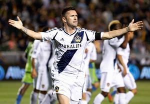 Los Angeles Galaxy's Robbie Keane celebrates scoring a goal against the Seattle Sounders last night