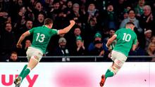 Ireland's Johnny Sexton (right) scores his first try during the Guinness Six Nations match at the Aviva Stadium, Dublin. Photo credit: Niall Carson/PA Wire.