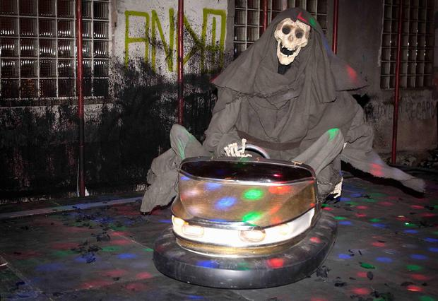 A Grim Reaper figure, riding a bumper car, is the newest art installation by British artist Banksy in New York