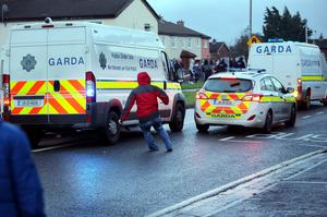 A rioter throws a brick at a garda car during a Anti Water charges demonstration in Jobstown on Saturday. Photo: Tony Gavin 15/11/2014