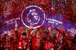 LIVERPOOL, ENGLAND - JULY 22: Liverpool players celebrate with The Premier League trophy following the Premier League match between Liverpool FC and Chelsea FC at Anfield on July 22, 2020 in Liverpool, England. Football Stadiums around Europe remain empty due to the Coronavirus Pandemic as Government social distancing laws prohibit fans inside venues resulting in all fixtures being played behind closed doors. (Photo by Phil Noble/Pool via Getty Images)