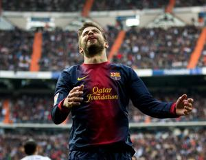 MADRID, SPAIN - MARCH 02:  Gerard Pique of Barcelona reacts during the la Liga match between Real Madrid CF and FC Barcelona at Estadio Santiago Bernabeu on March 2, 2013 in Madrid, Spain.  (Photo by Jasper Juinen/Getty Images)