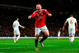 Manchester United's captain Wayne Rooney celebrates scoring his team's winner against Swansea City at Old Trafford on Saturday. Pics: Getty Images