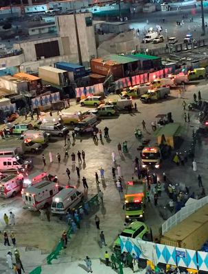 In this image released by the Saudi Interior Ministrys General Directorate of Civil Defense, emergency service vehicles are seen near the Grand Mosque in Mecca, after a crane collapsed killing dozens, Friday, Sept. 11, 2015. The accident happened as pilgrims from around the world converged on the city, Islam's holiest site, for the annual Hajj pilgrimage, which takes place this month. The civil defense authority announced the collapse and a series of rising casualty numbers on its official Twitter account. (Saudi Interior Ministry General Directorate of Civil Defense via AP)