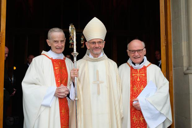 New Bishop of Raphoe Alan McGuckian (centre), with his brothers Fr Michael McGuckian (left), and Fr Bernard McGuckian at his ordination. Photo: Liam McArdle