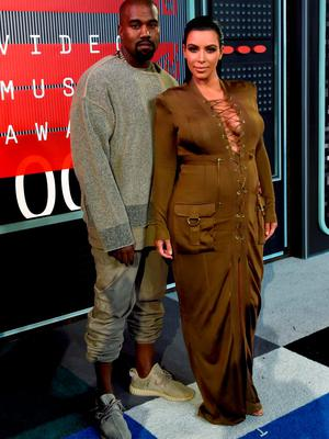 At the MTV VMAs in August, she wore am olive green gown.