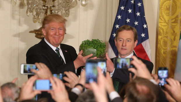 Taoiseach Enda Kenny presents the traditional bowl of shamrock to President Trump at the White House. Photo: Gerry Mooney