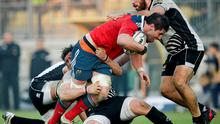 Munster's Dave O'Callaghan is tackled by Mauro Bergamasco and Alberto De Marchi of Zebre during the Pro12 clash in Parma