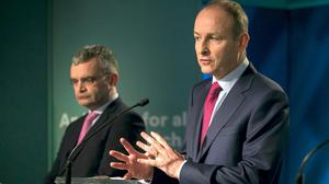 Saga: Dara Calleary (left) stepped down as Agriculture Minister, while Taoiseach Micheál Martin was less than clear in his message. Photo: Gareth Chaney/Collins
