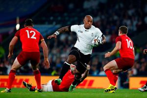Waisea Nayacalevu of Fiji evades a tackle by Ben Morgan of England during their  Rugby World Cup Pool match at Twickenham.  Photo by Shaun Botterill/Getty Images