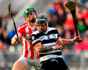 Midleton's Luke Dineen battles with Seamus Harnedy of Imokilly. Photo: Ramsey Cardy/Sportsfile