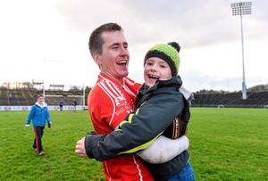 Cillian Brennan, Ballintubber, celebrates with Conor McManaman, age 8, from Ballintubber at the game.