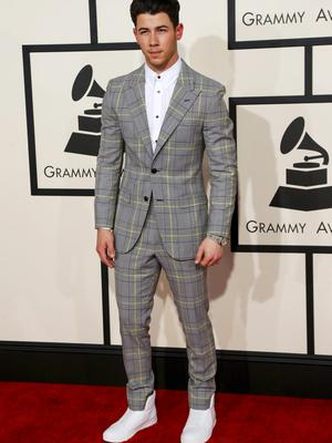 Singer Nick Jonas arrives at the 57th annual Grammy Awards in Los Angeles, California February 8, 2015.