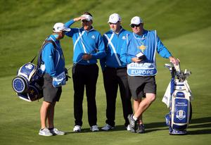 Europe's Ian Poulter (Second left), caddy Terry Mundy (left), Stephen Gallacher (second from right) and his caddy Damian Moore talk tactics during the Fourball matches on day one of the 40th Ryder Cup at Gleneagles Golf Course, Perthshire. PRESS ASSOCIATION Photo. Picture date: Friday September 26, 2014. Photo credit should read: Andrew Milligan/PA Wire. RESTRICTIONS: Use subject to restrictions. Editorial use only. No commercial use. Call +44 (0)1158 447447 for further information.