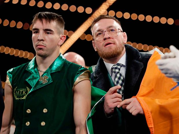 Ireland's Conor McGregor, right, and Michael Conlan