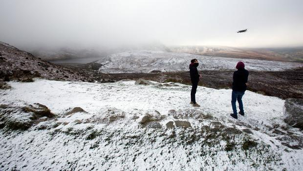 Drone flyers film the cold conditions at Lough Bray in Co. Wicklow. Photo: Tony Gavin 22/1/2018