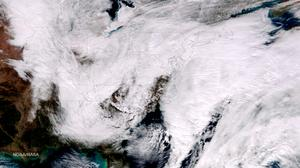 A winter storm approaching the eastern United States is seen in a NOAA satellite image taken at 1:25pm EST (18:25 GMT)January 26, 2015