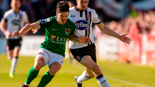 Jimmy Keohane of Cork City shoulders off Dundalk's Michael Duffy during yesterday's SSE Airtricity League Premier Division game at Turner's Cross. Photo: Diarmuid Greene/Sportsfile